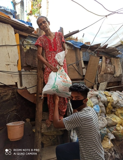 Distributing ration during Covid-19 (Image Source: CACR)