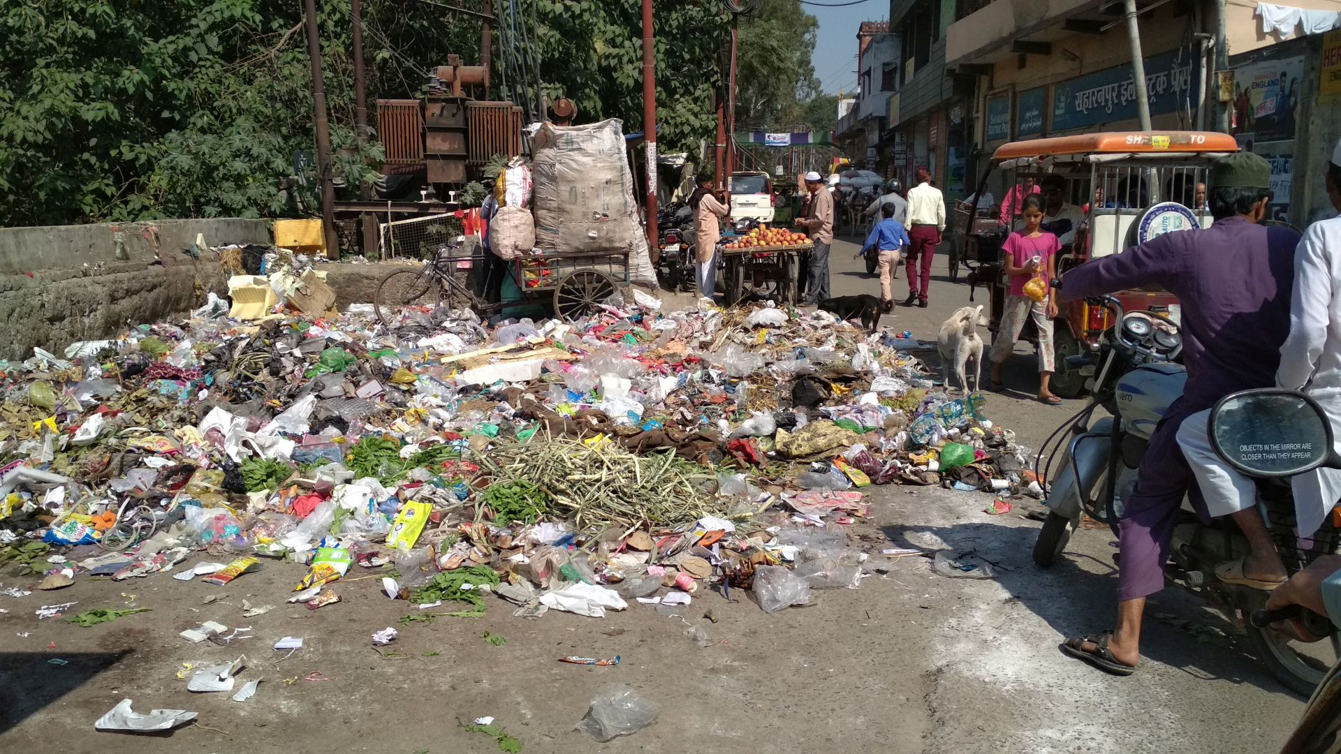 Heaps of garbage lie strewn in corners, lanes and markets along the river Paondhoi today. (Image: India Water Portal)