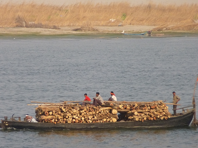 Boat carrying timber to the burning ghats of Varanasi