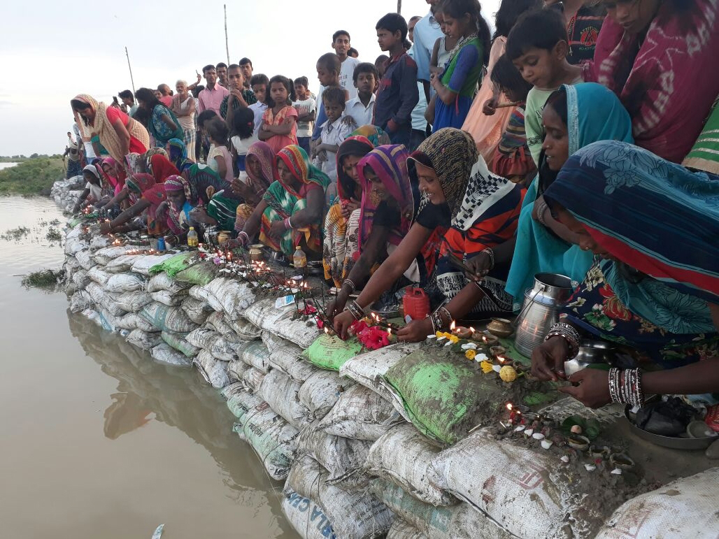 Women in Khagaria village in Bihar offer prayers to bring the flood situation under control. (Photo by Ritesh Kumar)
