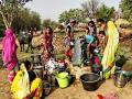 Women in Bametara district of Chattisgarh line up to collect water. Photo credit: Makarand Purohit for India Water Portal