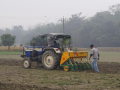 Zero tillage machine mounted on a tractor.