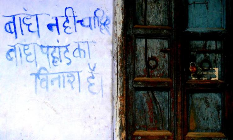 We don't want dams, dams destroy  mountains' reads a slogan painted on a wall in Uttarakhand (Image Source: GJ Lingaraj)