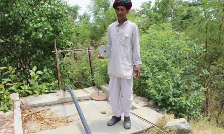 One of the Bhujal Jankaars measuring groundwater levels manually (Image: Basant Maheshwari)