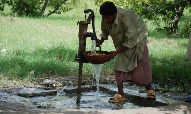 Using a handpump to extract groundwater (Source: Wikipedia)
