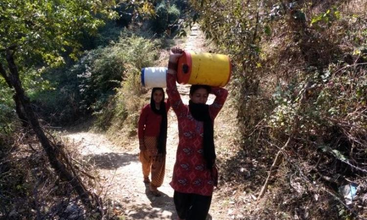 Women trudged long distances daily to fetch water for their basic household needs in Rupail (Image: People's Science Institute)